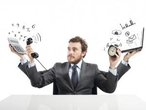 Concept of busy multitasking businessman at work